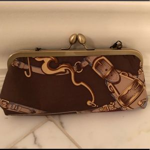 Equestrian-themed clutch with chain